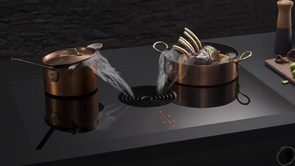 bora pure kochfeld mit rundem abzug und kupfer töpfe bei küchen staude