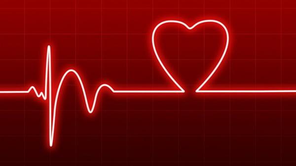 herzrhythmus in rot symbolbild für die gesundheit beim induktionskochfeld
