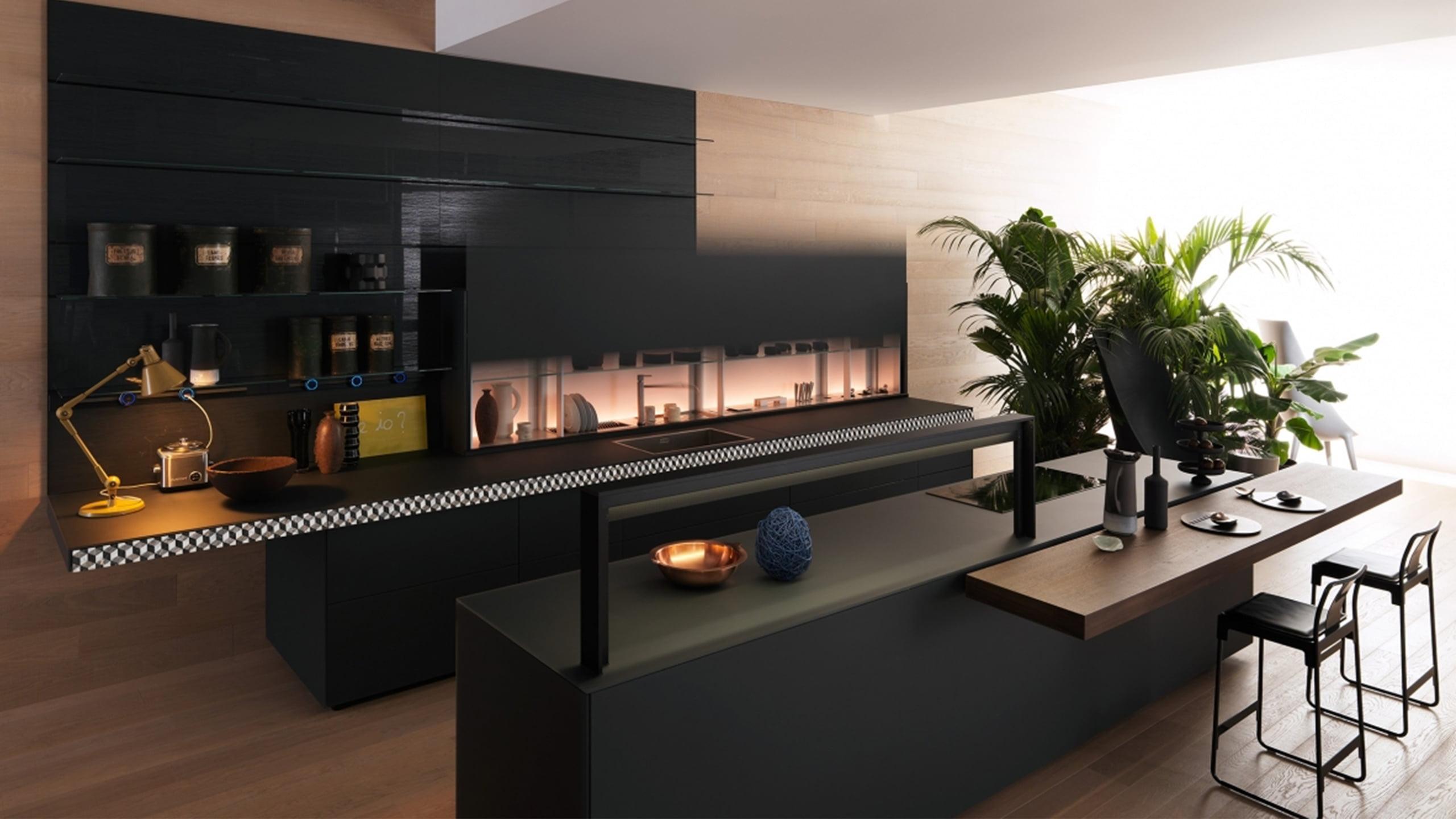 valcucine küche genius loci in schwarz mit lichtelementen und kücheninsel mit tresen und barhocker grifflos