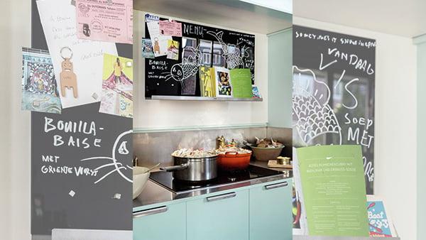 neff collection dunstabzugshaube mit beschreibbarer oberfläche und ablage für kochbücher in moderner küche
