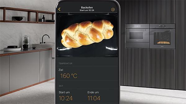 smartphone mit details zum inhalt des miele backofen der generation 7000 mit smarter foodview kamera