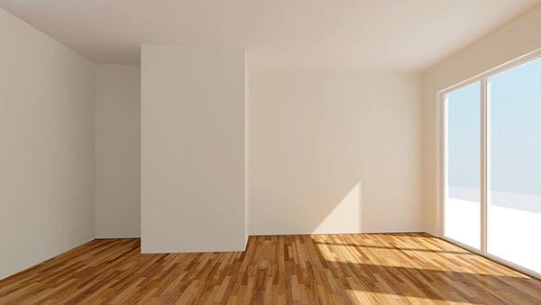 leerer Raum mit weißen wänden holzbodenbelag und großer fensterfront