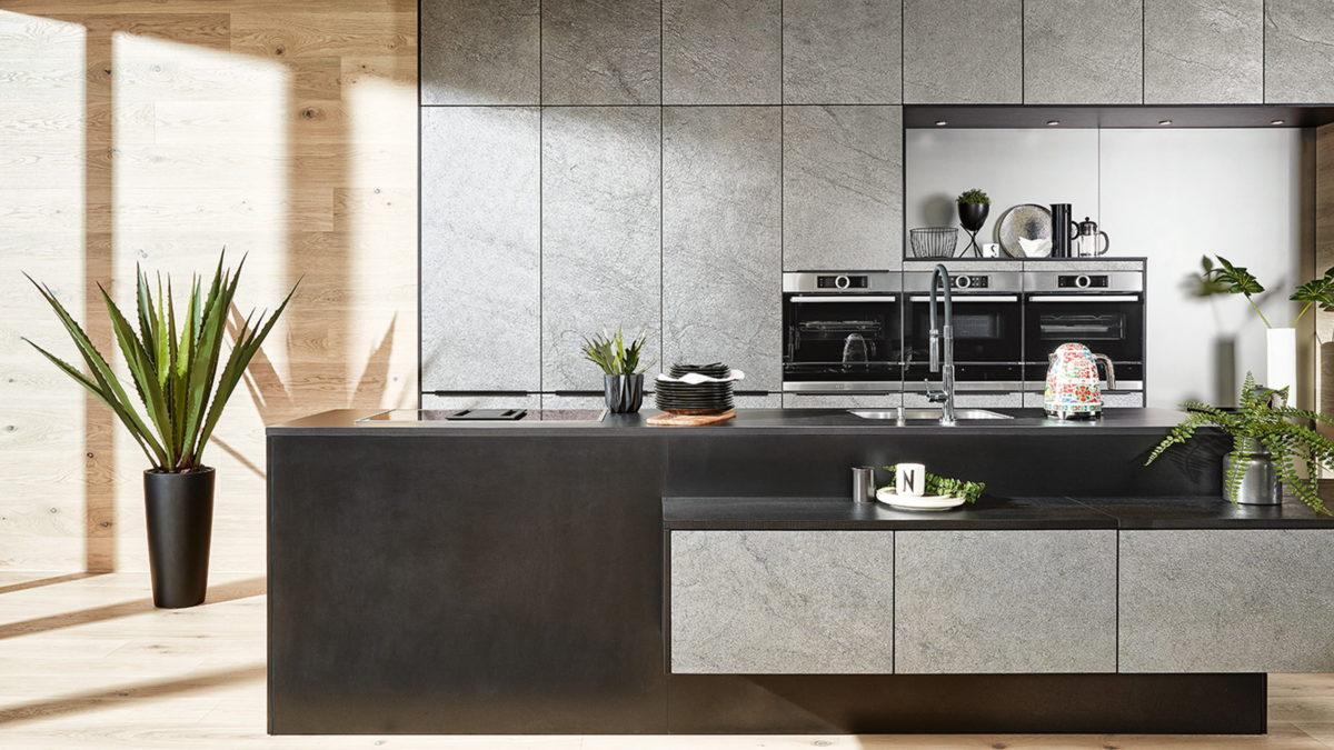 häcker öko küche mit pflanzen und front aus betonoptik